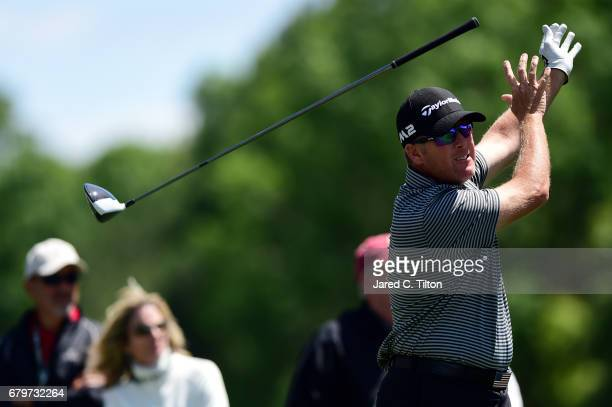 Points throws his club after playing his shot from the 12th tee during round three of the Wells Fargo Championship at Eagle Point Golf Club on May 6,...