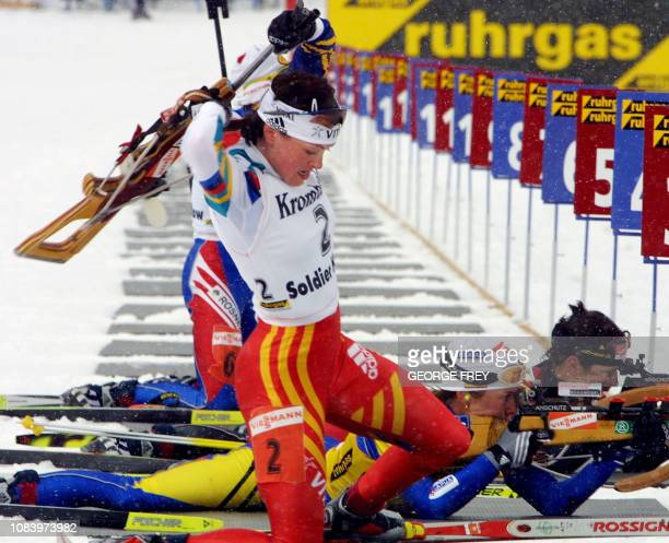 Poiree Liv Grete Skjelbreid of Norway prepares to ski again after shooting at the Ruhrgas World Cup Women's Biathlon at Solider Hollow 03 March 2001...