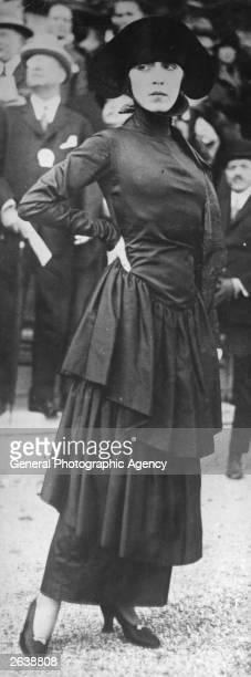 Poiret model dress of black marocain, with a severe neckline and flounced hobble skirt.