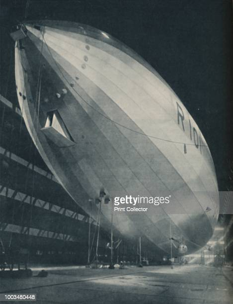 Poised in the Vast Hall of Her Birthplace, Ready To Take Wing', circa 1935. R 101 airship in her hanger. Royal Airship Works, Cardington,...