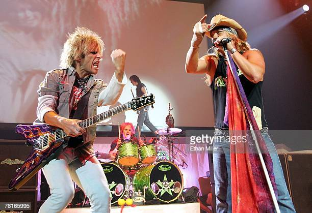 Poison guitarist CC DeVille drummer Rikki Rockett bassist Bobby Dall and singer Bret Michaels perform during a soldout show at the Pearl concert...