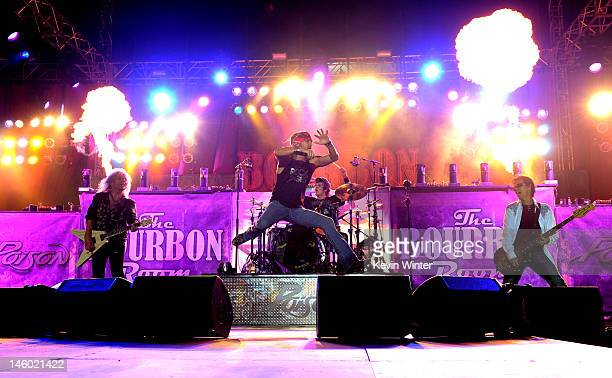 Poison, with singer Bret Michaels and musicians C.C. DeVille, Rikki Rockett and Bobby Dall performs at the after party for the premiere of Warner...