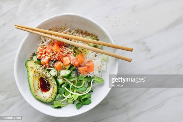 poke bowls with ponzu dressing - salad stock pictures, royalty-free photos & images