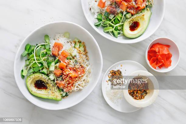 poke bowls with ponzu dressing - soy sauce stock photos and pictures