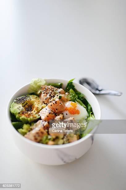 Poke salad bowl with salmon and avacado