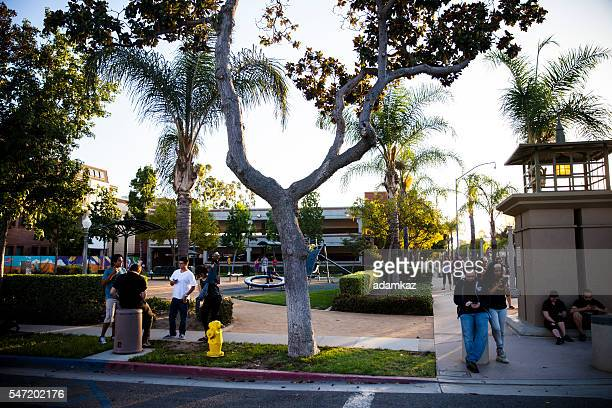 pokemon go app being played on iphone - fullerton california stock photos and pictures
