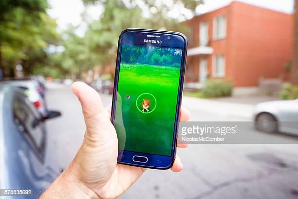 Pokemon go on Samsung phone lifestyle image urban setting