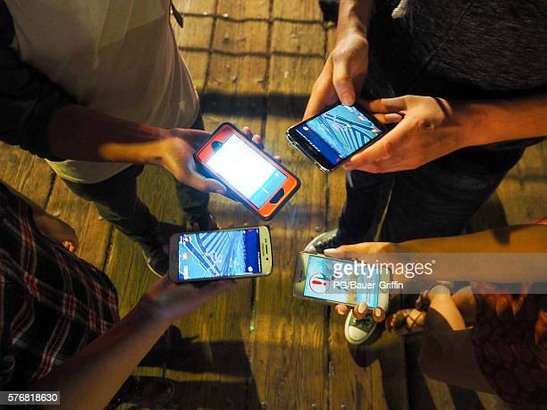 Pokemon Go players are seen in search of Pokemon and other in game items at the Santa Monica Pier on July 17 2016 in Los Angeles California