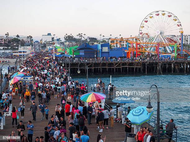 Pokemon Go players are seen in search of Pokemon and other in game items at the Santa Monica Pier on July 17, 2016 in Los Angeles, California.
