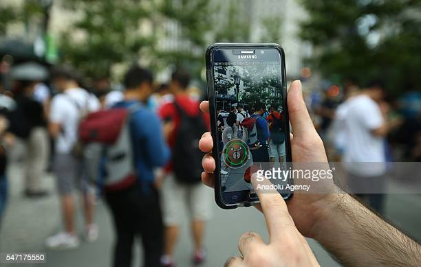 Pokemon Go user plays Pokemon GO game in New York City NY on July 13 2016 Pokemon Go is a freetoplay locationbased augmented reality mobile game...