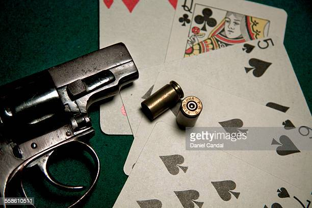 Poker cards and gun
