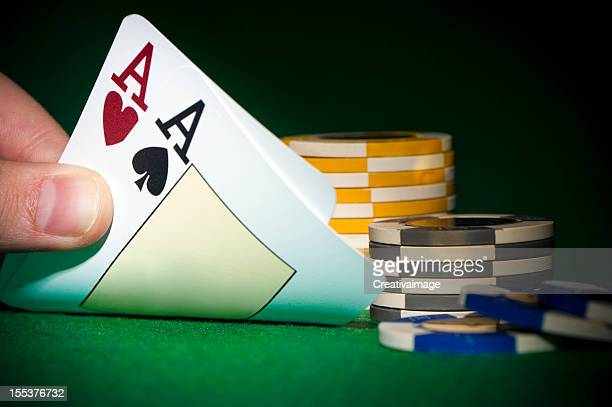 poker chips and a hand flip the cards - royal flush stock photos and pictures