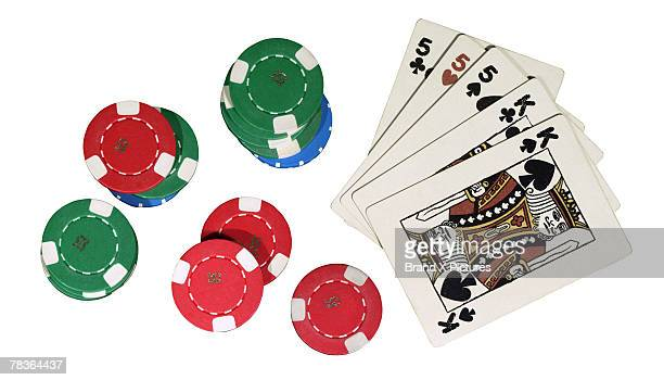 poker chips and cards - hand of cards stock photos and pictures