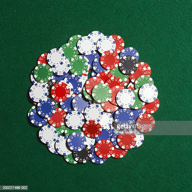 Poker chips in pile on casino table