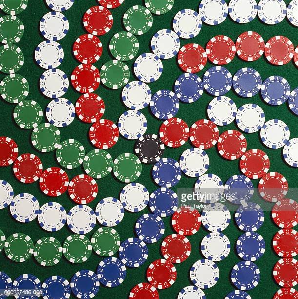 Poker chips lined up in star shape on casino table