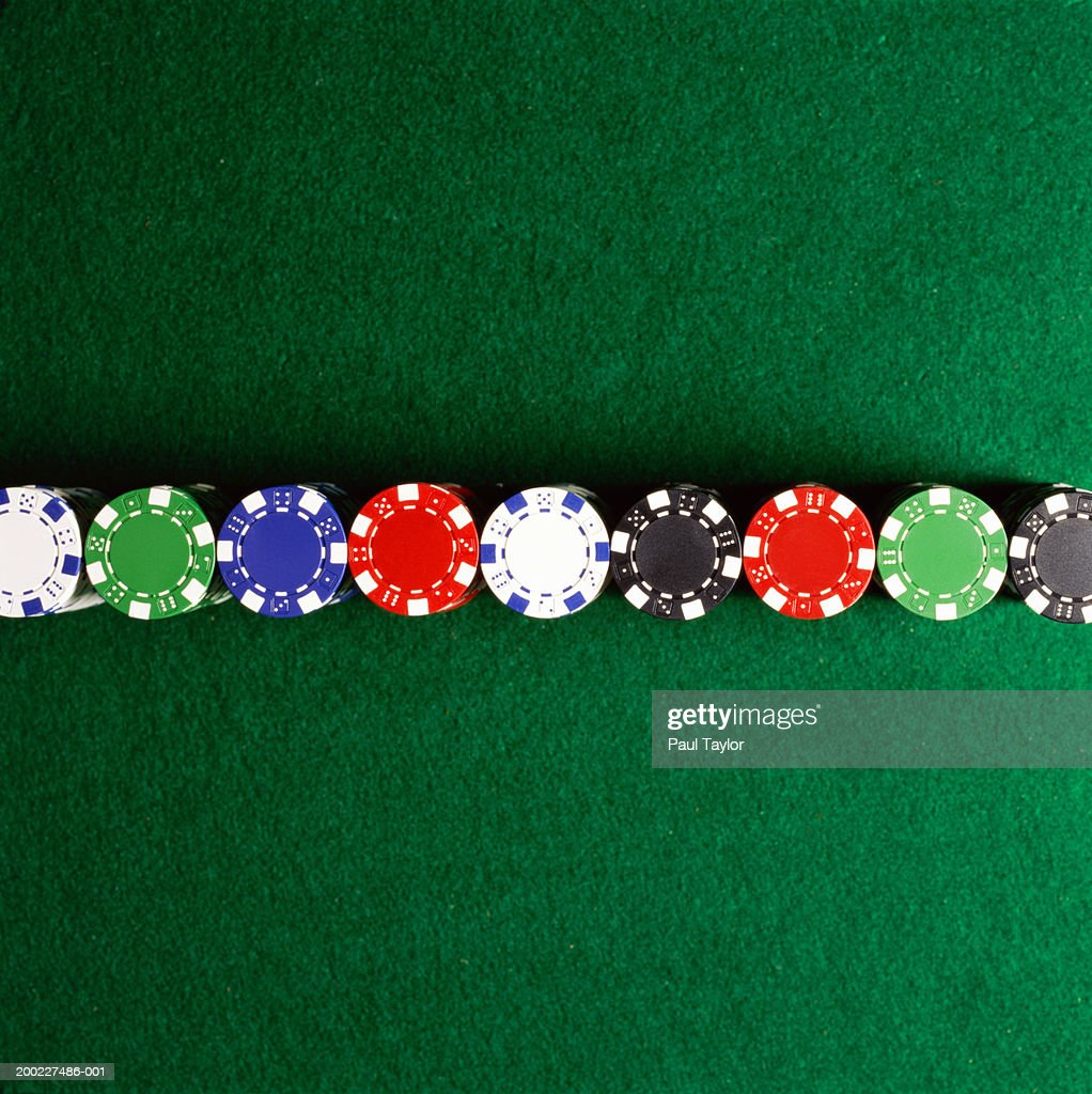 Poker chips lined up on casino table : Stock Photo