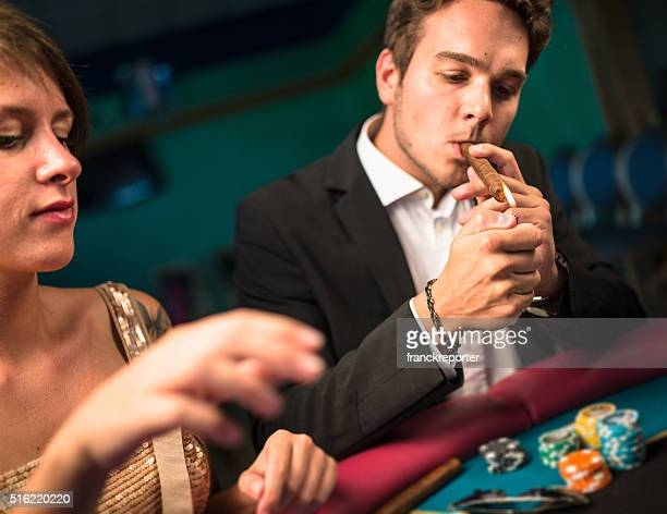 poker game at casino - texas hold 'em stock photos and pictures
