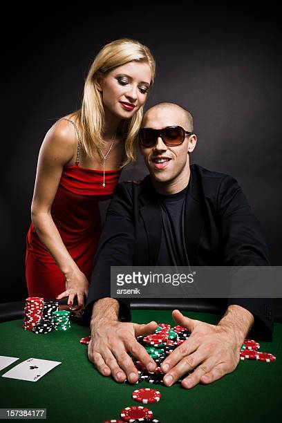 poker game - couple - bringing home the bacon stock pictures, royalty-free photos & images