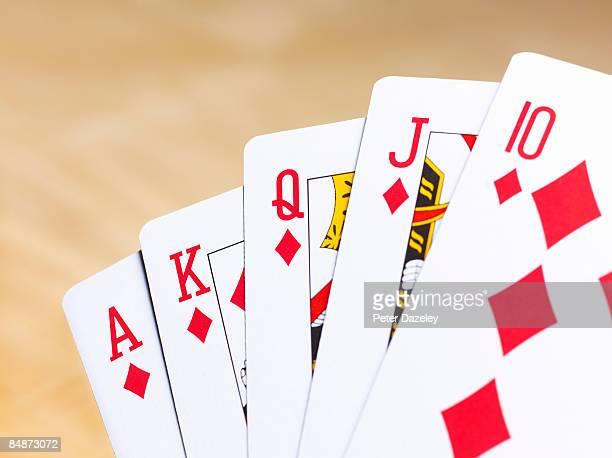 poker hand diamond running flush. - royal flush stock photos and pictures