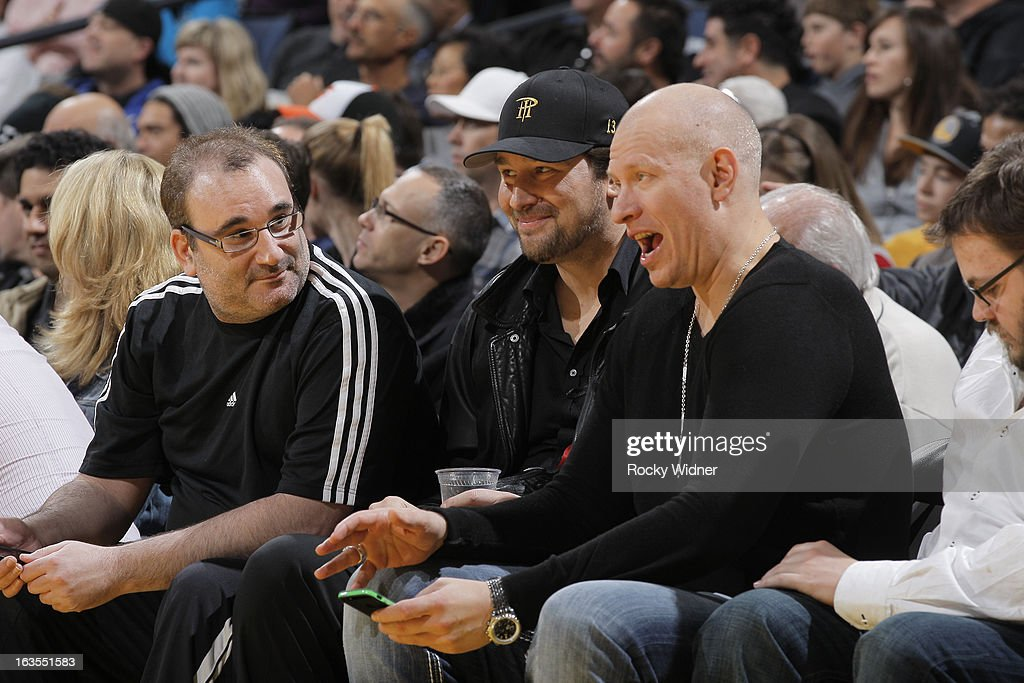 Poker player Mike Matusow and Phil Hellmuth attend the game between the Sacramento Kings and Golden State Warriors on March 6, 2013 at Oracle Arena in Oakland, California.
