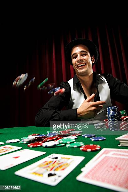 Poker player throwing chips at table