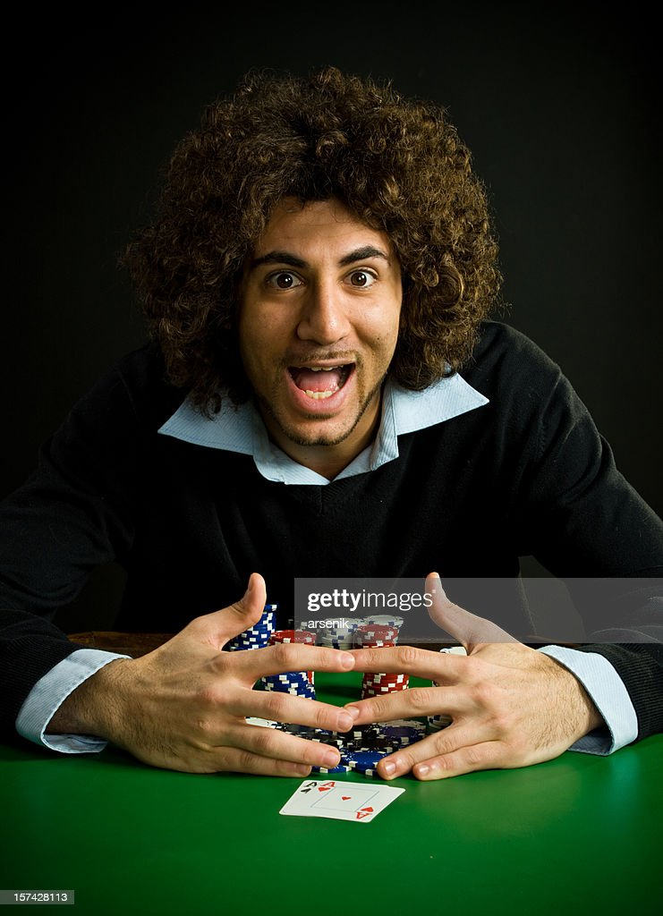 Poker player wins pot : Stock Photo