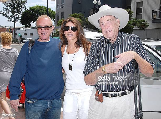 Poker Star Chip Reese Donna Baldwin and Poker Star Doyle Brunson pose at day two of the Ivy Hotel Premiere on August 25 2007 in San Diego California