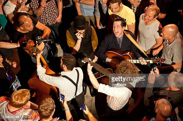 Pokey LaFarge of Pokey LaFarge The South City Three performs the last encore of his show with the audience during Take Root Festival at De Oosterport...