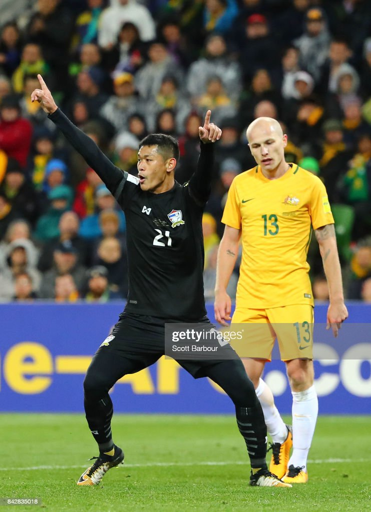 Pokkhao Anan of Thailand celebrates after scoring a goal as Aaron Mooy of the Socceroos looks dejected during the 2018 FIFA World Cup Qualifier match between the Australian Socceroos and Thailand at AAMI Park on September 5, 2017 in Melbourne, Australia.