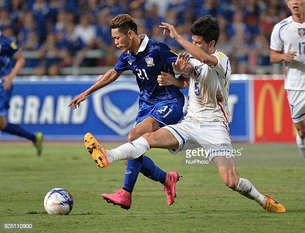 Pokklaw Anan of Thailand fights for the ball with Yaki Yen of Taiwan during their 2018 FIFA World Cup Qualifier asian group F match at Rajamangala...