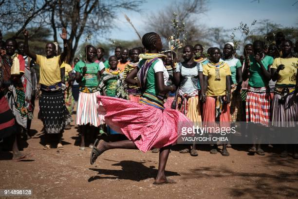 TOPSHOT Pokot tribe women sing and dance before their meeting with jounalists on the topic of female genital mutilation on January 30 2018 in Katabok...