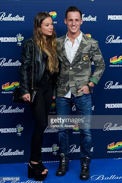 Pol Espargaro and Carlota Beltran attend the '40 Principales Awards' 2013 photocall at Palacio de los Deportes on December 12 2013 in Madrid Spain