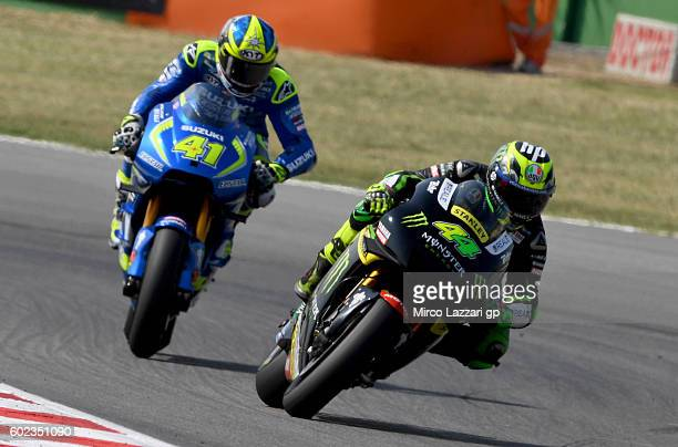 Pol Espargaro of Monster Yamaha Tech 3 team and Aleix Espargaro of Team SUZUKI ECSTAR in action during MotoGP of San Marino race at Misano World...