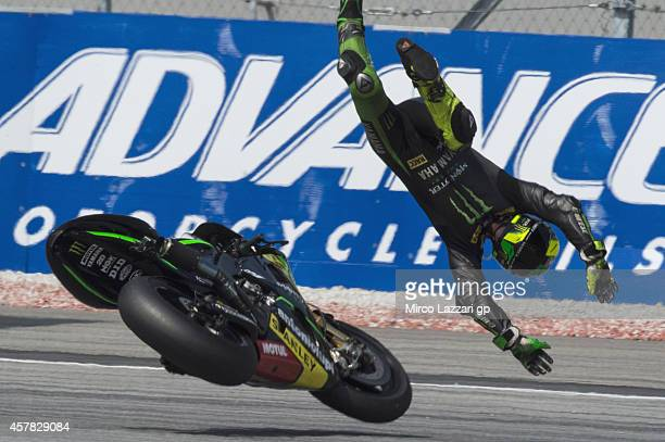 Pol Espargaro of Spain and Monster Yamaha Tech 3 crashes out during the MotoGP Of Malaysia Qualifying at Sepang Circuit on October 25 2014 in Kuala...