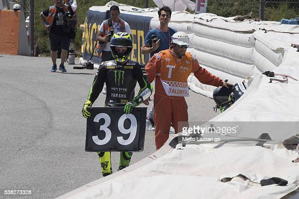 Pol Espargaro of Spain and Monster Yamaha Tech 3 greets and remembers Luis Salom of Spain and SAG Team on the corner of accident at the end of the...