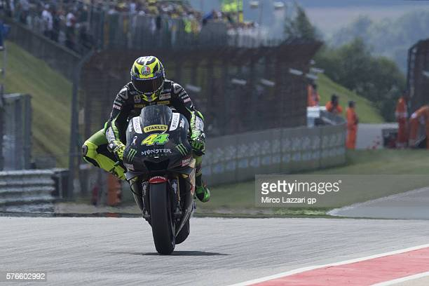 Pol Espargaro of Spain and Monster Yamaha Tech 3 lifts the rear wheel during the MotoGp of Germany Qualifying at Sachsenring Circuit on July 16 2016...