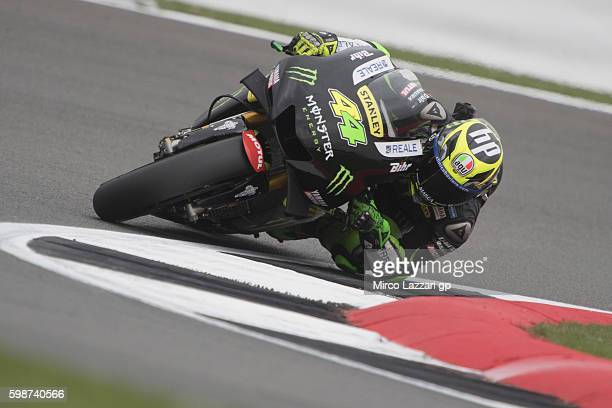 Pol Espargaro of Spain and Monster Yamaha Tech 3 rounds the bend during the MotoGp Of Great Britain Free Practice at Silverstone Circuit on September...