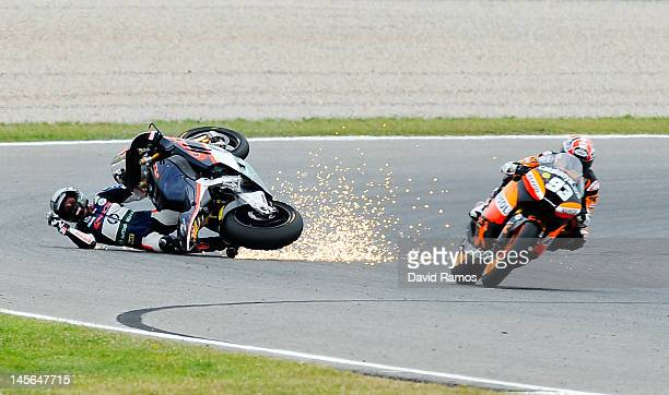 Pol Espargaro of Spain and Pons 40 HP Tuenti after crashing with Marc Marquez of Spain and Team CatalunyaCaixa Repsol during the Moto2 race at...