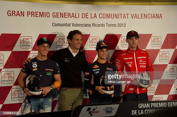 Pol Espargaro of Spain and Pons 40 HP Tuenti Dani Pedrosa of Spain and Repsol Honda Team and Jonas Folger of Germany and Mapfre Aspar Team Moto3 pose...