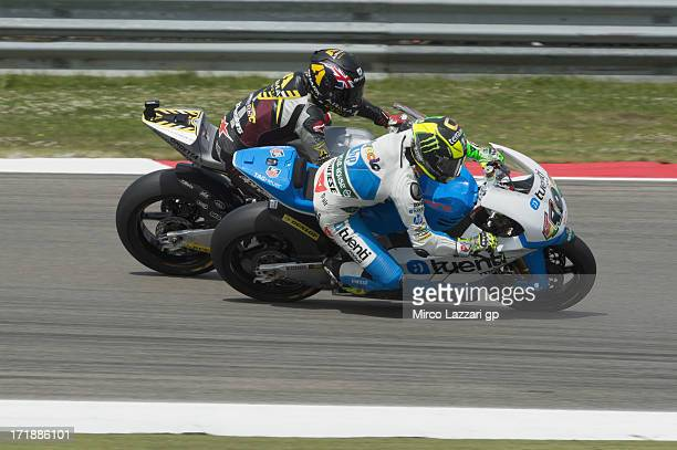 Pol Espargaro of Spain and Pons 40 HP Tuenti leads Scott Redding of Great Britain and Marc VDS Racing Team during the Moto2 race during the MotoGp Of...