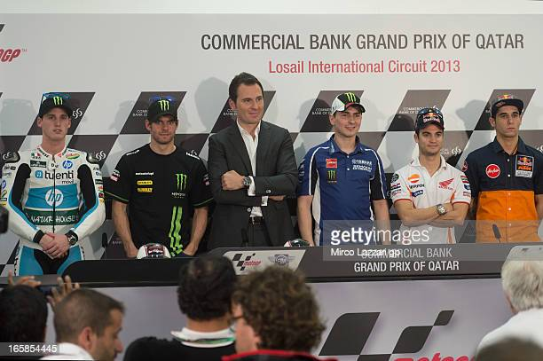 Pol Espargaro of Spain and Pons 40 HP Tuenti Luis Salom of Spain and Red Bull KTM Ajo Cal Crutchlow of Great Britain and Monster Yamaha Tech 3 Jorge...
