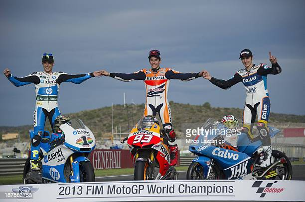 Pol Espargaro of Spain and Pons 40 HP Tuenti Marc Marquez of Spain and Repsol Honda Team and Maverick Vinales of Spain and Team Calvo pose on track...