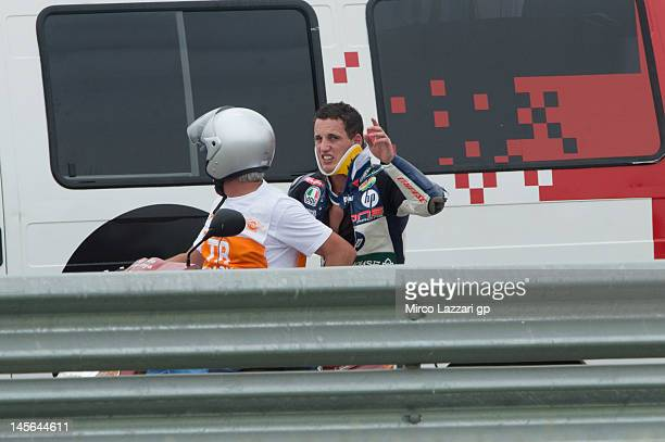 Pol Espargaro of Spain and Pons 40 HP Tuenti with the medical staff after crashing out during the Moto2 race of the MotoGp Of Catalunya at Circuit de...