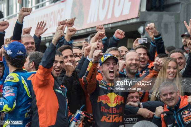Pol Espargaro of Spain and Red Bull KTM Factory Racing celebrates with team the third place under the podium at the end of the MotoGP race during the...