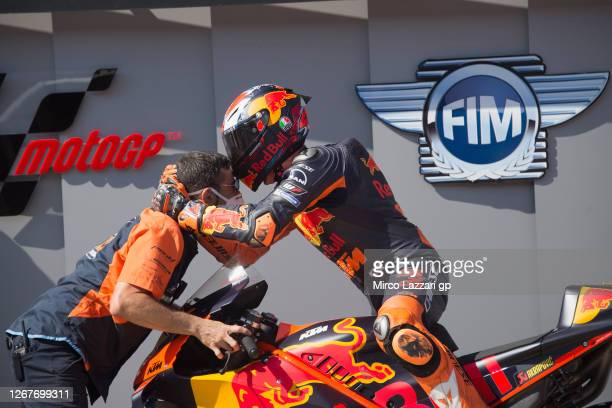 Pol Espargaro of Spain and Red Bull KTM Factory Racing celebrates pole position with mechanic the MotoGP at the end of the qualifying practice during...