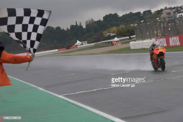 Pol Espargaro of Spain and Red Bull KTM Factory Racing cuts the finish lane and celebrates the third place at the end of the MotoGP race during the...
