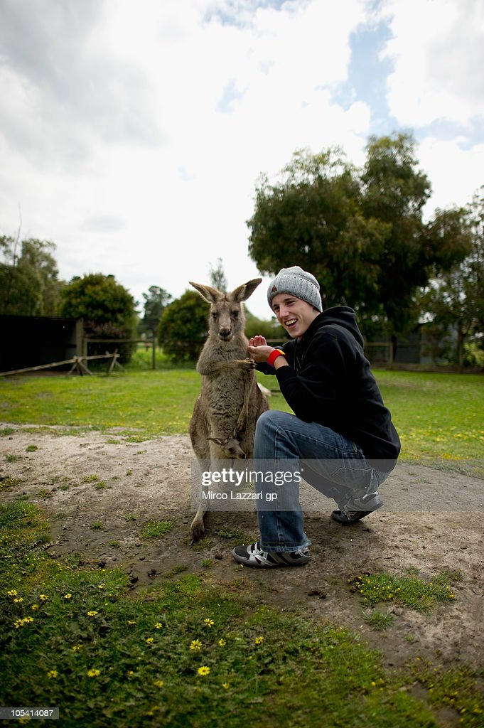 Pol Espargaro of Spain and Tuenti Racing meets a kangaroo during the pre-event 'MotoGP riders visit Maru Wildlife Park' of Australian Grand Prix at Phillip Island on October 14, 2010 in Phillip Island, Victoria, Australia.