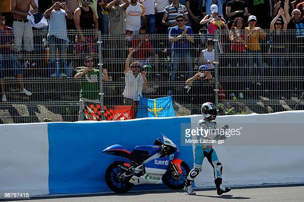 Pol Espargaro of Spain and Tuenti Racing parks the bike in order to celebrate the victory in front of his fans at the end of the 125 cc race at...