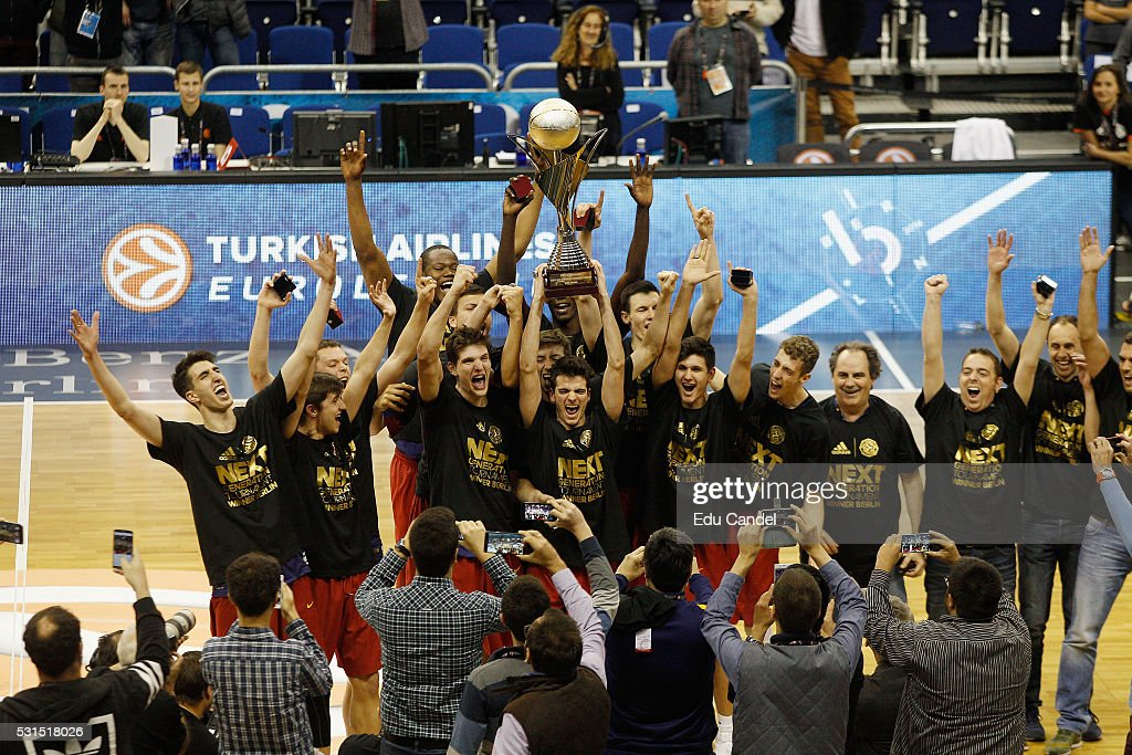 Pol Figueras, #7 of U18 FC Barcelona Lassa with the trophy during the Turkish Airlines Euroleague Basketball Adidas Next Generation Tournament Championship game between U18 FC Barcelona Lassa v U18 Crvena Zvezda Telekom Belgrade at Mercedes Benz Arena on May 15, 2016 in Berlin, Germany.
