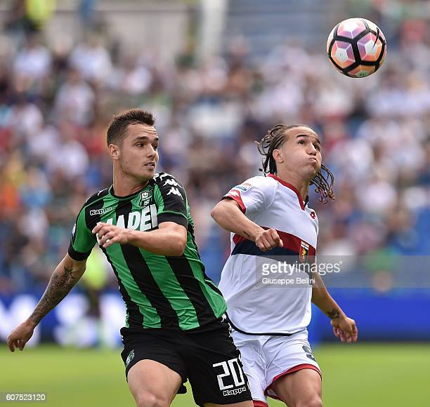 Pol Lirola of US Sassuolo and Diego Laxalt of Genoa CFC in action during the Serie A match between US Sassuolo and Genoa CFC at Mapei Stadium Citta'...